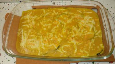Calabacines gratinados con crema de calabaza, curry y queso