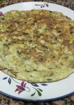 Tortilla de champiñones con ajito y perejil