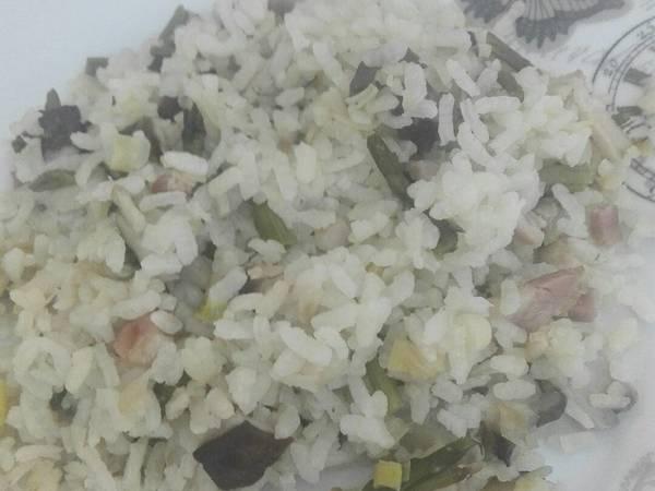 Arroz salteado con trigueros y setas shiitake