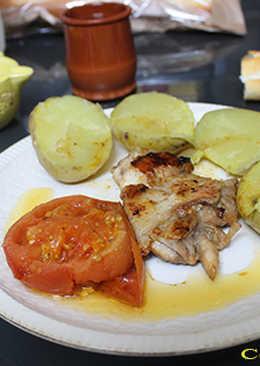 Pollo con patatas asadas