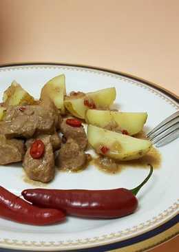 Magro de cerdo en salsa de vino tinto con soja y chile rojo