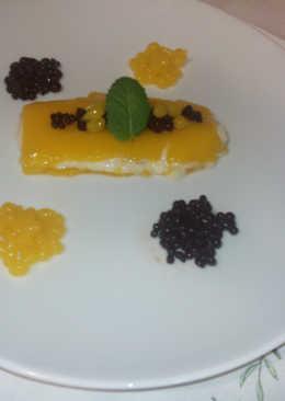 Arroz con leche con geleé de mango, caviar de chocolate y perlas de mango