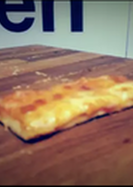 Pizza casera de jamòn dulce y queso