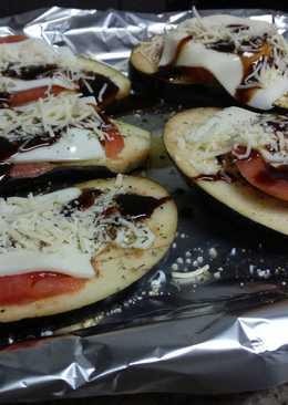 Berenjenas con queso, Módena y miel al horno