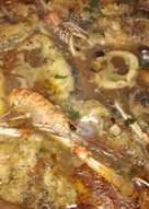 Suquet de corvina con cigalas y calamares