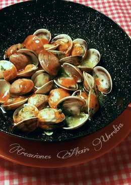 Almejas en salsa de ajos, perejil con un toques de salsa thai