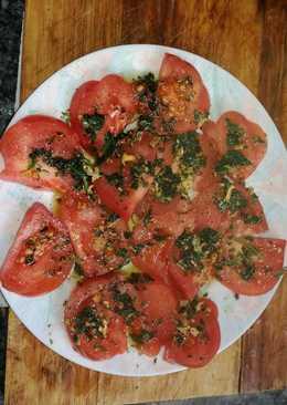 Tomates raf con refrito de ajo y perejil