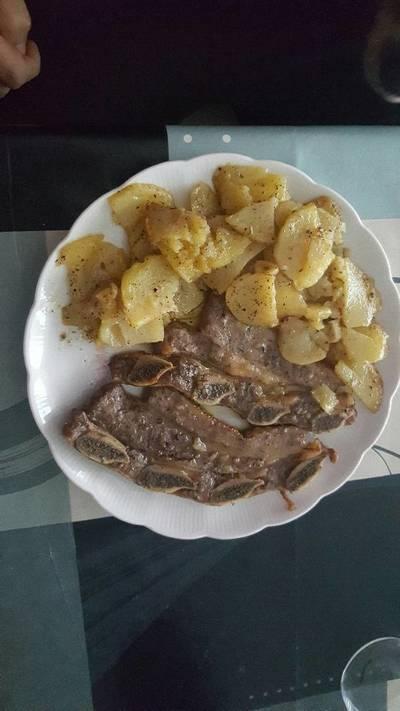 Churrasco al horno con patatas a las hierbas provenzales