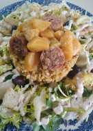 Esqueixada de bacalao con nido de arroz, butifarra con manzana