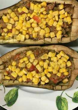 Berenjenas rellenas y maíz