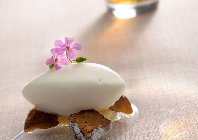 Dátil en crudo y en agua con helado de almendra amarga, bomboncitos de naranja y flores de almendra