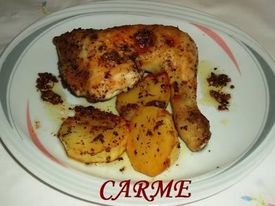 Pollo asado al limón con hierbas aromáticas y patatas