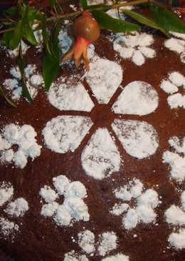 Pastel integral de almendras, nueces de macadamia y ciruelas pasas