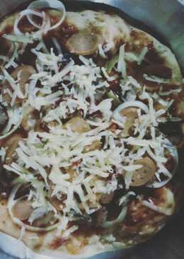 Pizza homemade with onion mashroom and cheese