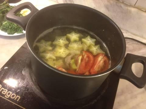 Canh bắp bò nấu khế và cà chua recipe step 4 photo