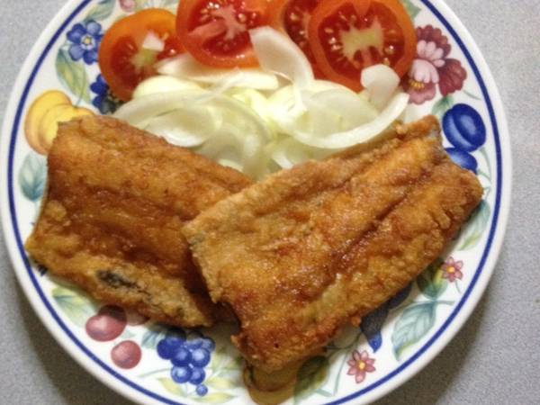 - fried boneless bangus for breakfast with fried rice and fresh tomatoes.