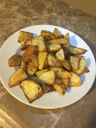 طريقة عمل بطاطس بالفرن (بوتيتو ويدجز)