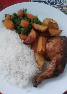 أفخاذ الدجاج المشوية بالأرز والخضار