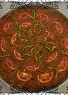 صينية لحم بعصير الطماطم والطحينه