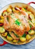 Запечённая целиком курица с картошкой