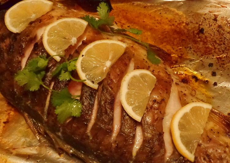 Рыба, фаршированная морковью и луком