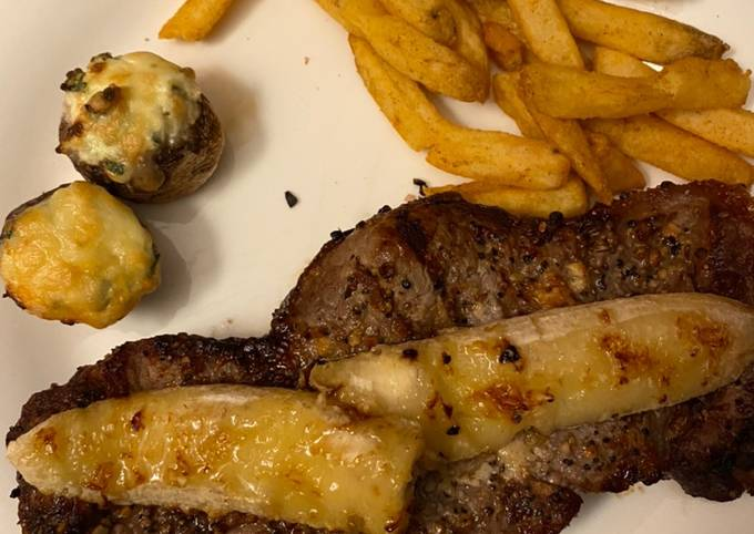 🥰Dinner for 2 date night 😍 Grilled steak, wt (grilled banana)stuffed spinach mushrooms and fries❤️