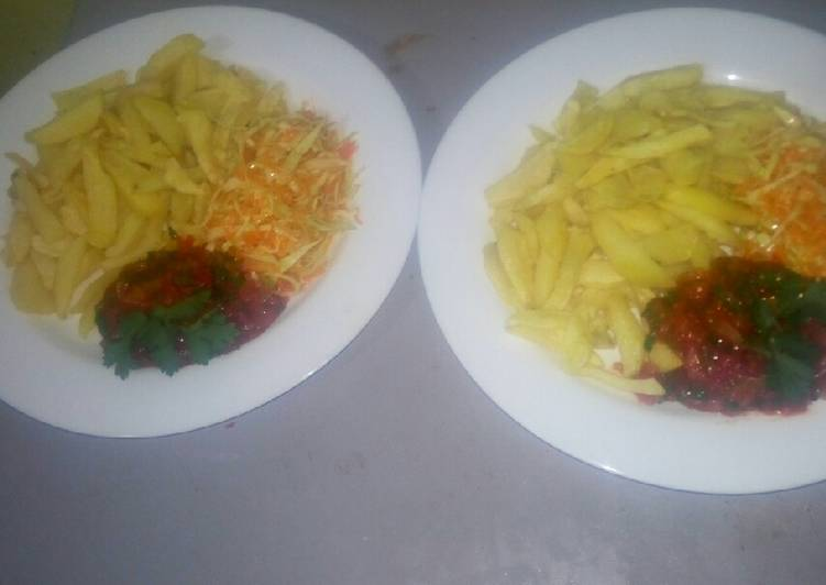 Simple Way to Prepare Homemade Oven baked fries,salad,tomato onion source