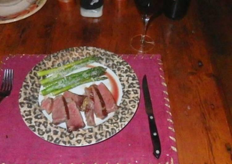 Sous vide aged prime strip steak with parmesan Asparagus