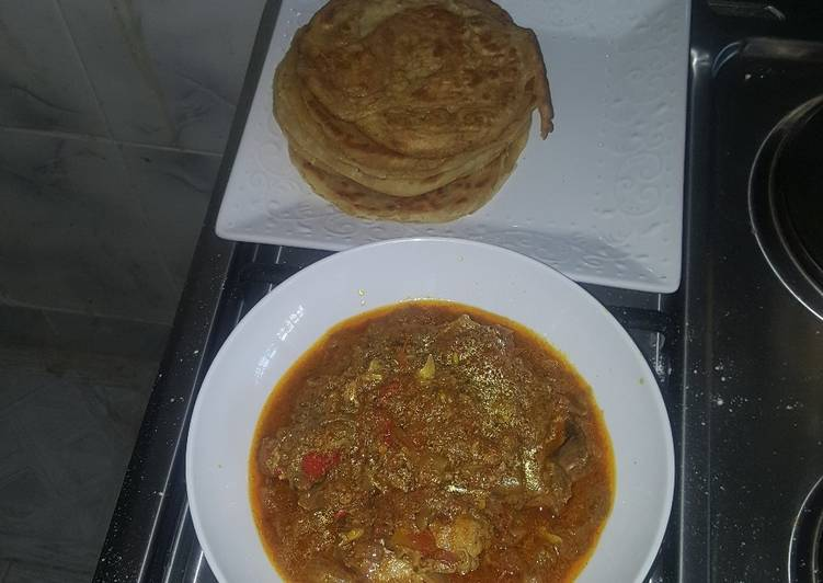 Naan bread and chicken curry