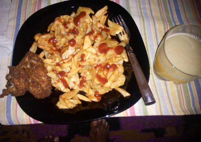 French fries, coated chicken and fresh pineapple juice...
