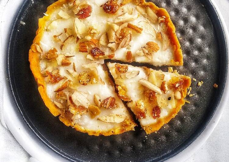 Steps to Prepare Favorite Besan laddoo tart filled with rice pudding topped with nuts