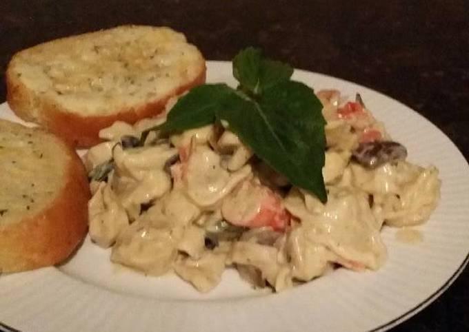 Brad's seafood tortillini in white wine alfredo