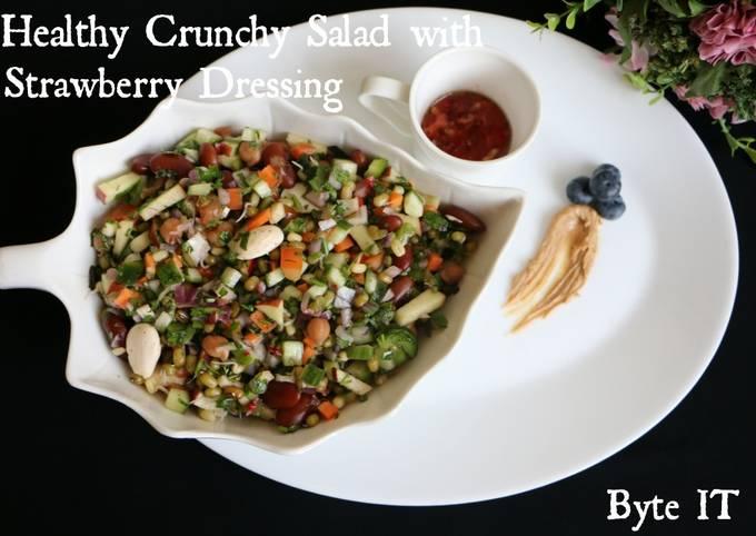 Healthy crunchy salad with strawberry dressing