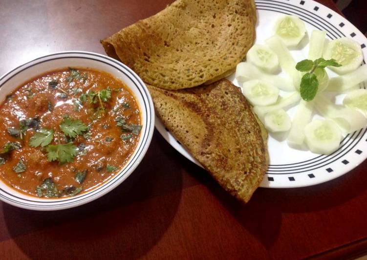 Mung masoor chila with meatballs in tangy tomato gravy
