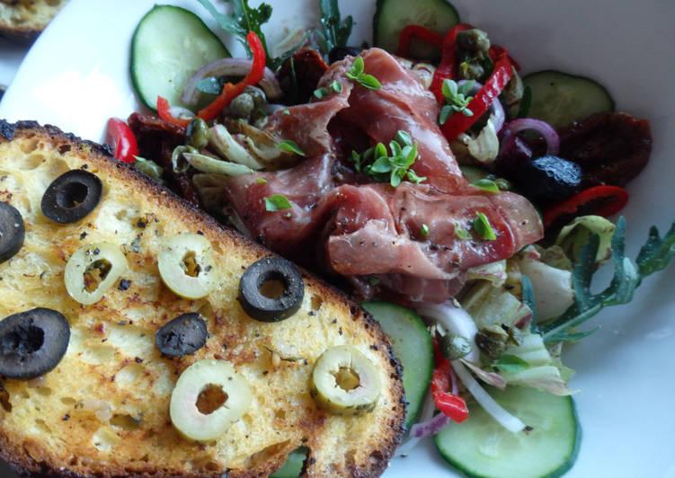 Bresaola mariné et tartine aux olives