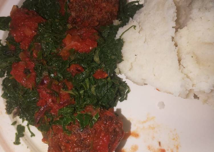 Ugali served with Meatballs and sukuma wiki