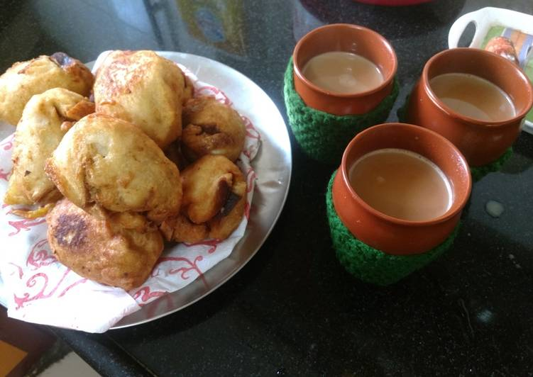 Bread roll, paneer roll, bread pakode with masala tea - Laurie G Edwards