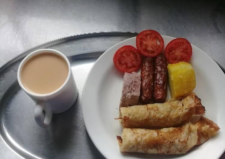 Orange pancakes, beef sausages, Arrowroots, sweetpotatoes, tea - Laurie G Edwards
