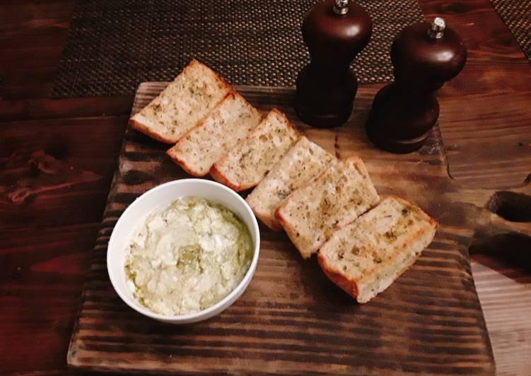 Toasted onion poppy ciabatta bread with goat cheese and pesto