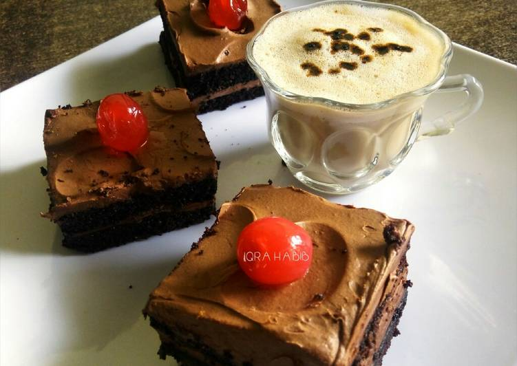Chocolate squares with hot coffee