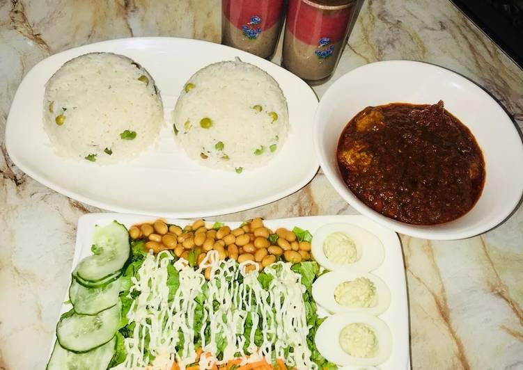 White rice wt chicken ball stew &salad wt devilled eggs