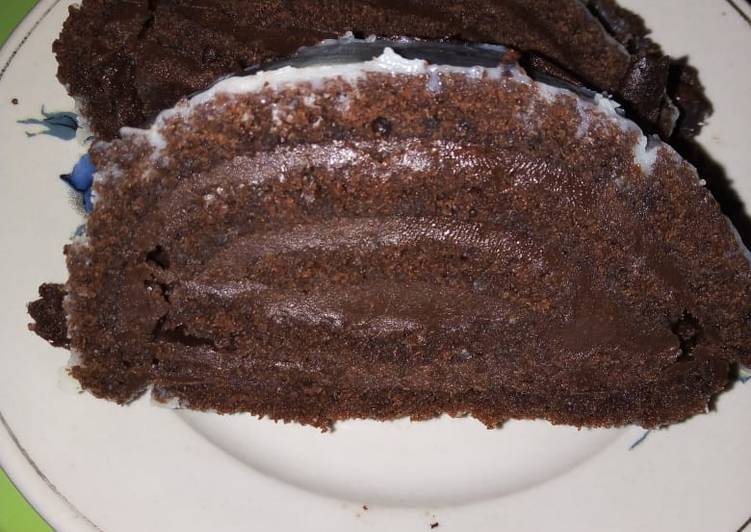 Chocolate roll cake with chocolate buttercream frosting