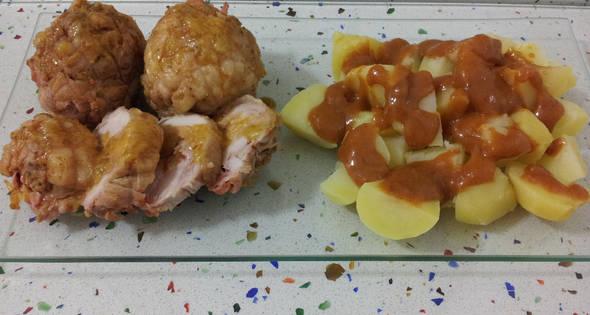 Muslos Rellenos De Jamón Y Queso Con Patatas En Salsa Brava