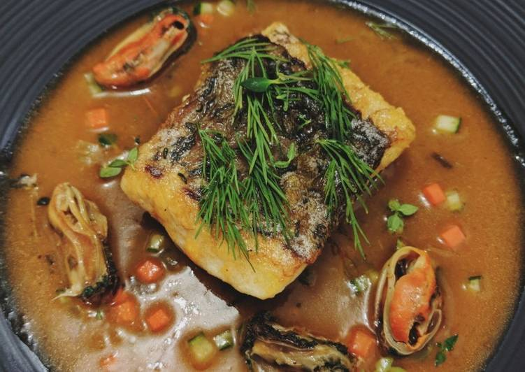 Seabass served with mussels in tomato sauce