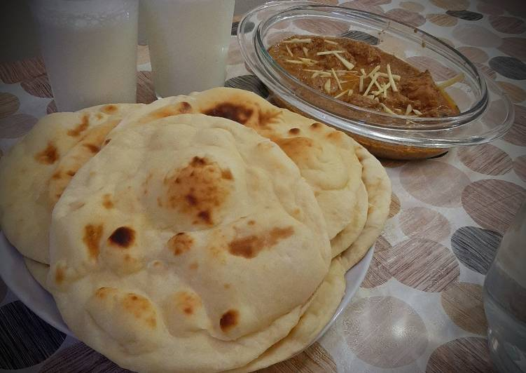 Chicken Qorma with homemade naans and lassi