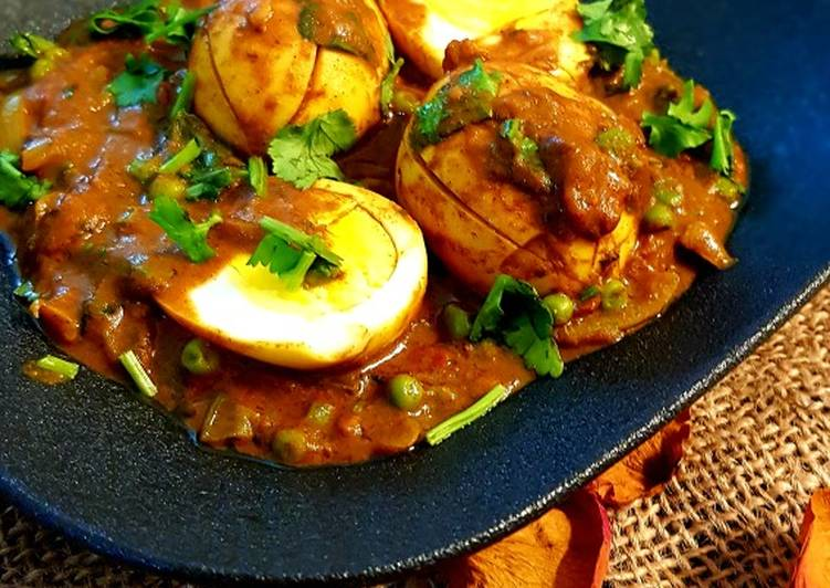 Boiled egg curry with peas