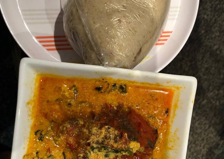 Egusi soup and cabbage swallow