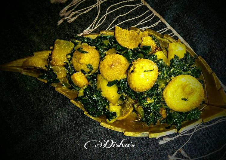 Jute leaves curry with pumpkin-potato-sundried lentil dumplings