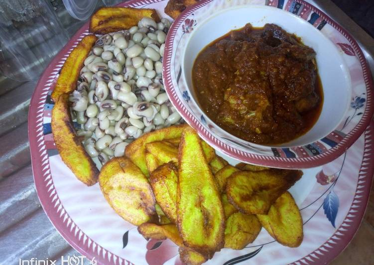 Fried plantain,boiled beans and fish stew