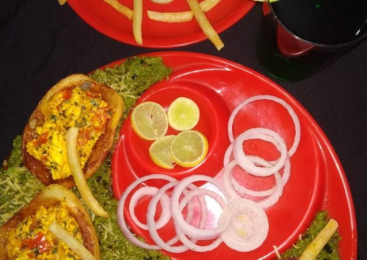 Potato boat loaded with paneer bhurji in green peas gravy